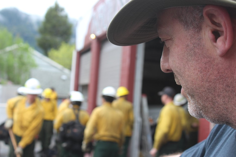 Dillon Sanders looks on as a collection ofwildlandfirefighters train for an upcoming season. Sanders is the owner of Inbound LLC in Oakridge, Oregon, which runs 20-person hand crews and 13 engines for fire suppression.