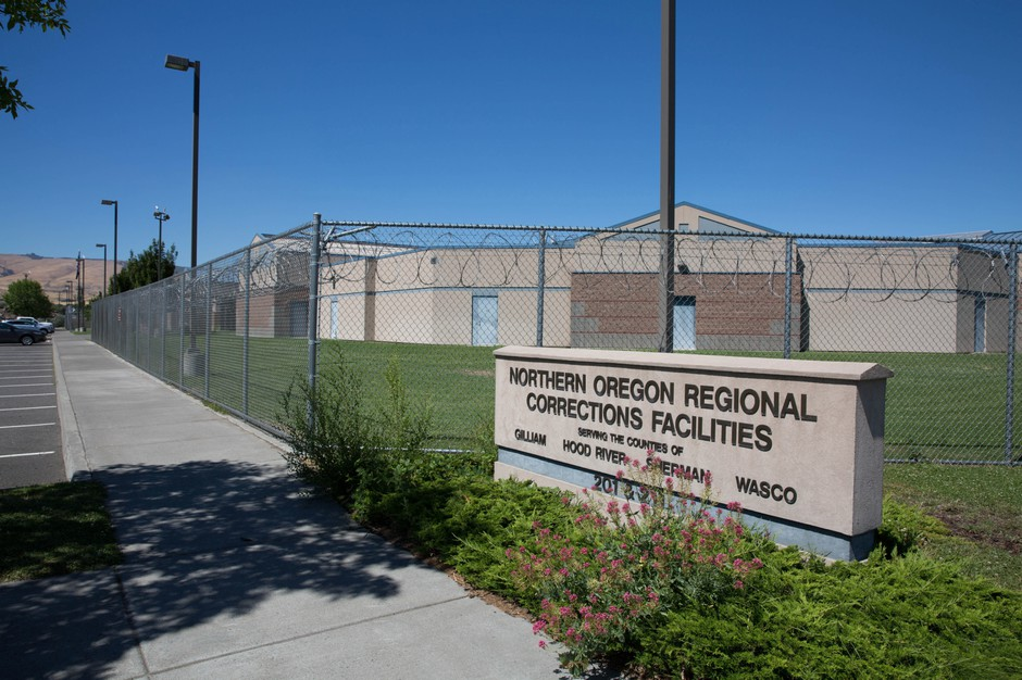 NORCOR is a cinder block jail surrounded by a high chain-link fence and razor wire in an industrial section of The Dalles, Oregon.