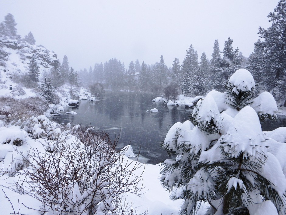 A view of the Deschutes River near First Street rapids in Bend, after a winter storm dumped over a foot of snow overnight on February 25, 2019.