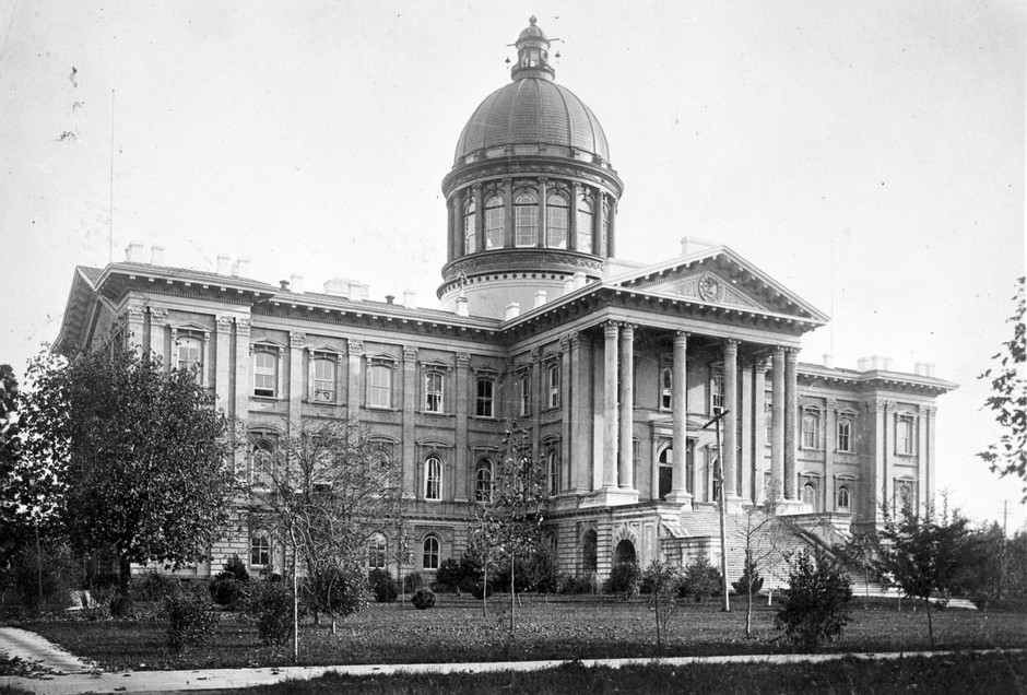 The Oregon State Capitol building of 1876. Carrie B. Shelton served as acting governor of Oregon from this building for roughly 49 hours in 1909. The building was destroyed by a fire on the night of April 25, 1935.