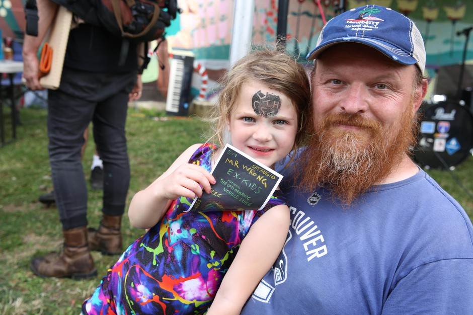 Lucy with her father, Alex Yusimov, enjoying the Kid's Punk Rock Matinee that they organized together.