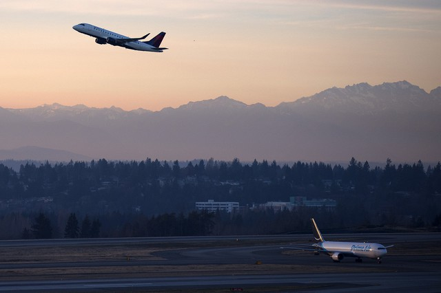 A plane takes off on Monday, December 11, 2017, at Seattle-Tacoma International Airport.