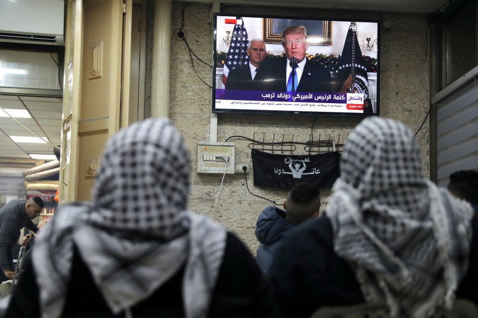 Palestinians watch a televised broadcast of U.S. President Donald Trump delivering an address where he announced that the United States recognizes Jerusalem as the capital of Israel, in Jerusalem's Old City Dec. 6, 2017.